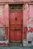 Old red front door with peeling paint Royalty Free Stock Image