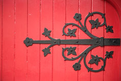 Old red gate of a church. Wooden gate of a church, with iron pattern Stock Photography