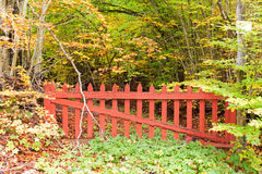 Old red gate in the woods Stock Photo