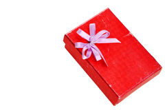 Old red gift box with lid and bow. Red gift box with lid and bow on a white background Royalty Free Stock Images