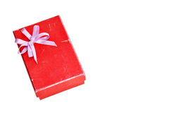 Old red gift box with lid and bow. Red gift box with lid and bow on a white background Stock Photo