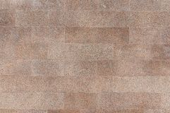 Old red granite stone wall background texture Stock Images