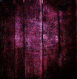 Old red grunge wood background with knots and scratches Stock Image