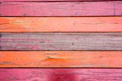 Old, red grunge wood vertical panels on a rustic barn Royalty Free Stock Photos