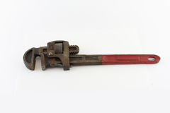 Old red handled pipe wrench stock images