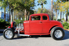 Old red hot-rod Car. The old Ford hot-rod car on the street Stock Photography