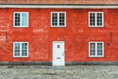 Old red house with white windows and door Royalty Free Stock Photography