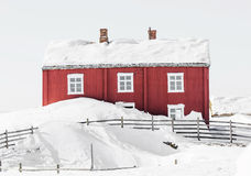 Red house. Old red house in winter landscape Royalty Free Stock Images