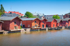 Old red houses on the river coast in Porvoo Stock Photography