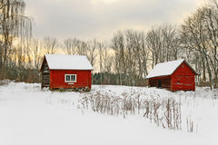 Old red houses in a winter landscape stock photos