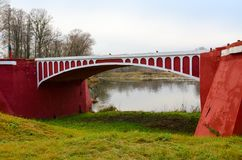 Old Red Humpbacked bridge 1927, Dobrush, Belarus. Old Red `Humpbacked` bridge year of construction 1927, Dobrush, Belarus stock photos
