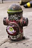 Old red hydrant on the sidewalk Royalty Free Stock Photo