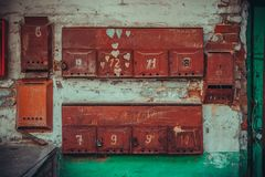 Old red iron mailboxes stock photography