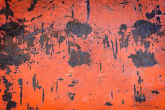 Old red iron wall has rust and stains on the background Stock Photos