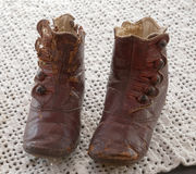 Old red leather baby boot Royalty Free Stock Images
