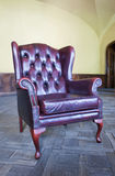 Old red leather chair in the interior Royalty Free Stock Image