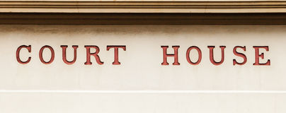 Old Red Letters on Public Historic Building Stating COURT HOUSE Royalty Free Stock Images
