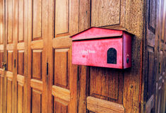 Old red mail box on the wood background Royalty Free Stock Image