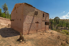 Old red Malagasy mud house Stock Photo