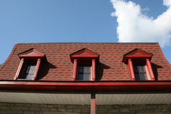 Old red mansard roof. Old french canadian home mansard roof in red Stock Photo