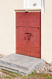 Old red massive gate in church Royalty Free Stock Photography