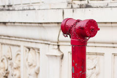 Old red metallic fire hydrant plug Stock Images