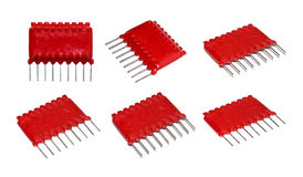 Old red microchip on a white background isolated. Old red microchip on a white background isolated Stock Photography