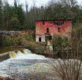 Old Red Mill. Old abandoned red grist mill in Alabama Stock Image