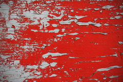Old red paint on grey Stock Images