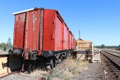 Old red painted wooden train carriages at the Muckleford railway. Station in Australia stock image