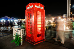 Old red payphone surrounded with people. The old payphone on the Walking Street market at Bangsean Chonburi Thailand royalty free stock photography