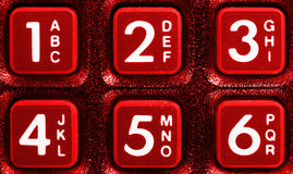 Old red phone keypad closeup Stock Images