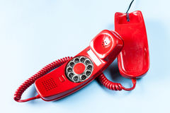 Old red phone off the hook Stock Photo