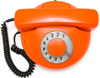 Old red phone on white background Stock Photography