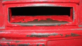 Old red post box. Image of a london old fashioned red post box, conceptual snail mail stock images
