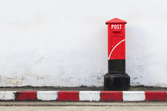 Old red postbox. On the street. over light Royalty Free Stock Photos