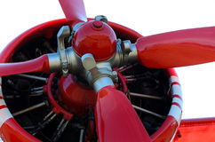Old red propeller airplane piston engine. Retro red propeller airplane piston engine Stock Photos
