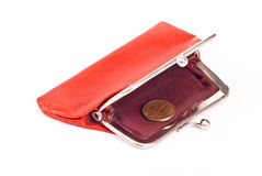 Old red purse. Against with coin Stock Image