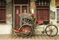 Old red rickshaw and heritage house, Penang, Malaysia. Old red rickshaw and heritage house, George Town, Penang, Malaysia Stock Image