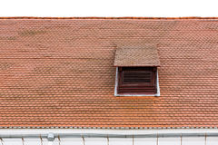 Old red roof with dormer window. Weathered red tiled roof with dormer window Stock Images