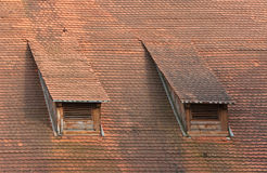 Old red roof tiles Stock Images