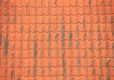 Old red roof tiles with black patina Stock Photo