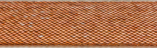 Old red roof tiles. Details of an old roof with reddish tiles Stock Photography