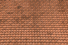 Old red roof tiles texture and blue sky background Royalty Free Stock Image