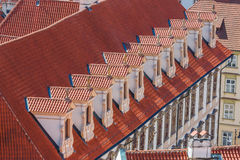 Old red roof with white windows Royalty Free Stock Photos
