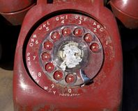 Old red rotary phone. Stock Image