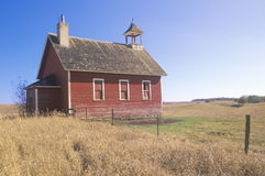 Old red schoolhouse on prairie Stock Photo