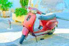 Old red scooter Royalty Free Stock Images