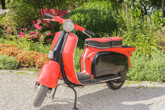 Old red scooter Stock Photography