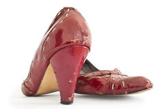 Old Red Shoes. A pair of old high heel shoes shot on white background Royalty Free Stock Photos